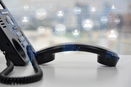 IP Phone double exposure with blue LED world map and business icon of VOIP human and  for communication concept Standard-Bild - 118981974