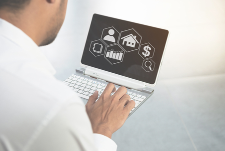 Man is using the laptop with business icon for marketing concept Standard-Bild - 118982032