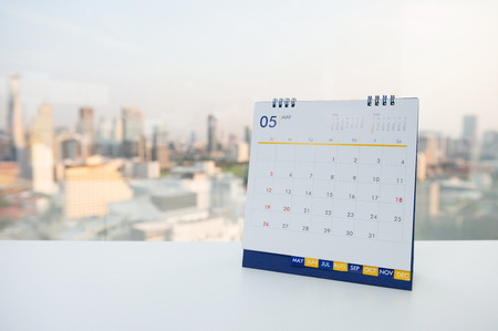 Calendar of May on the white table with city view background Banco de Imagens - 121547703