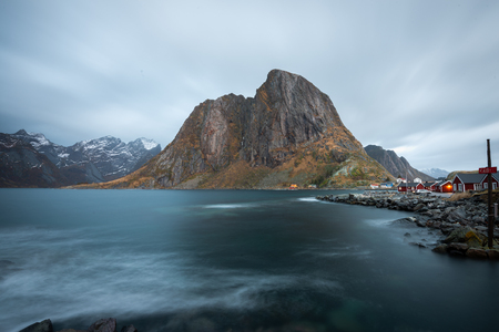 Long exposure of red fishing rorbuer house village with mountain view in Lofoten island Hamnoy Norway Stock Photo