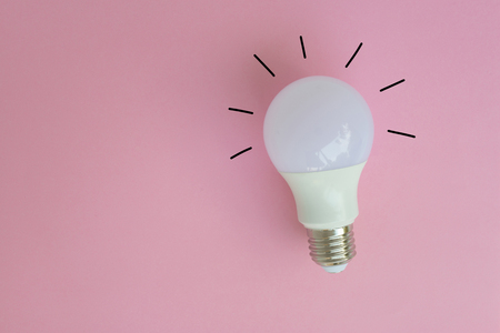 LED bulb with lighting from drawing on the pink background for idea concept
