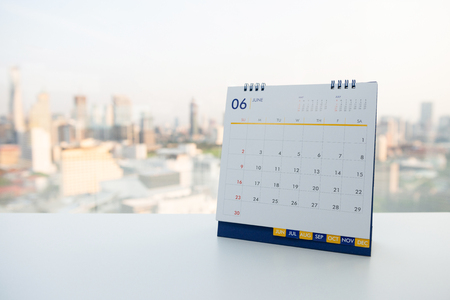 Calendar of June on the white table with city view background