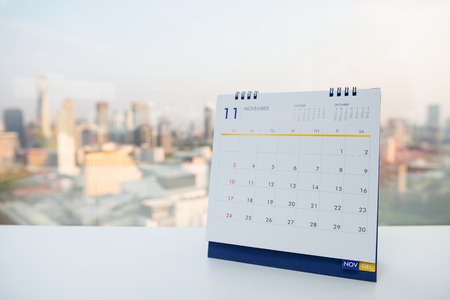 Calendar of November on the white table with city view background