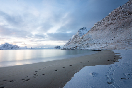 Long exposure polar night landscape of beach with mountain in the winter Banco de Imagens