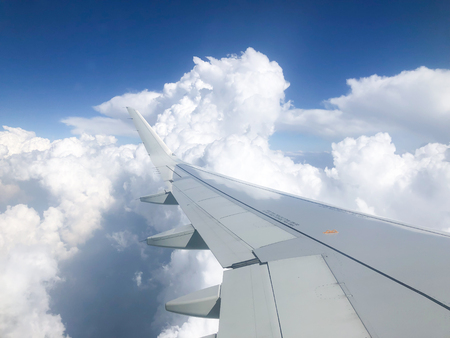 Aircraft wing fly through the clouds