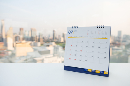Calendar of July on the white table with city view background