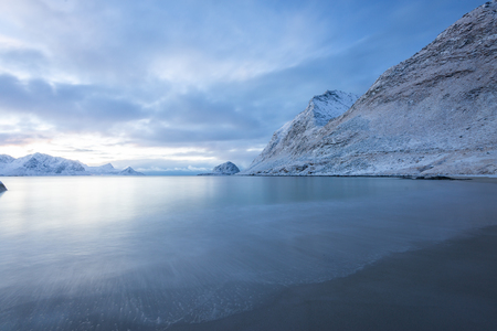 Long exposure polar night landscape of Haukland beach with mountain in the winter at Lofoten Norway