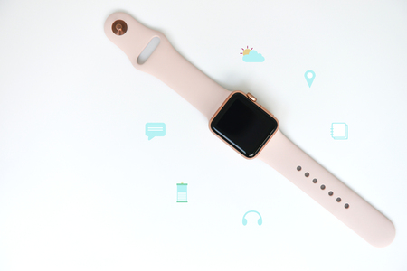 Pink woman smart watch with media icon on the white for watch technology concept