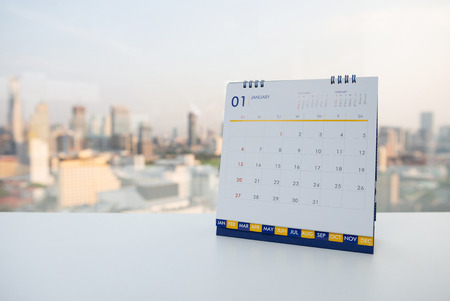 Calendar of January on the white table with city view background