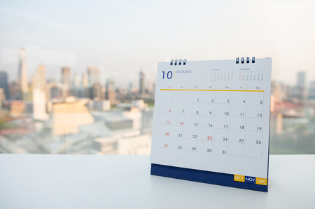 Calendar of October on the white table with city view background