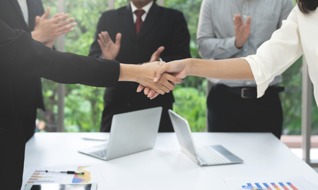 Business people hand shake in the meeting to deal the business