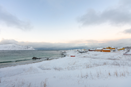 Landscape winter with snow and colourful house village Lofoten Norway Banco de Imagens - 121552257
