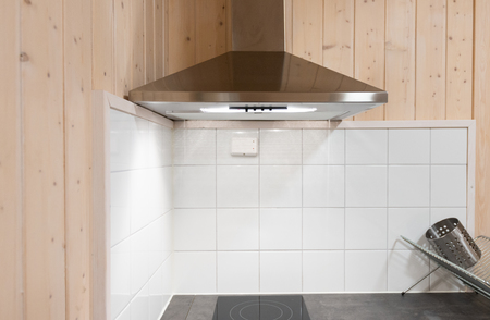 Stainless still hood is in the modern kitchen