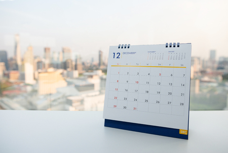Calendar of December on the white table with city view background Banco de Imagens - 121552283