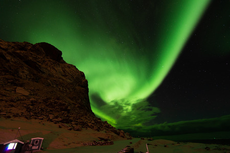 North green lighting of aurora over the mountains in Lofoten island Norway