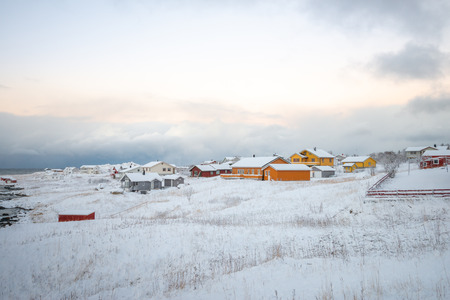 Landscape colourful house village in winter with snow at Lofoten Norway