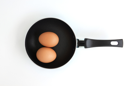 Pan with eggs on the white screen Banco de Imagens