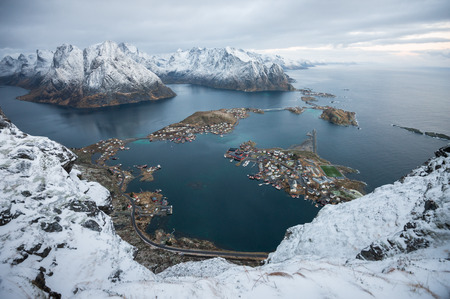 Landscape top view of Raine village and mountain islands from the peak of reinebringen