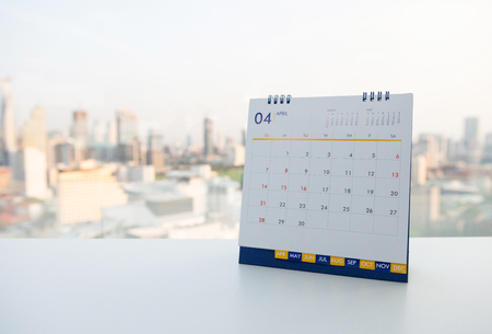 Calendar of April on the white table with city view background Banco de Imagens - 121552517