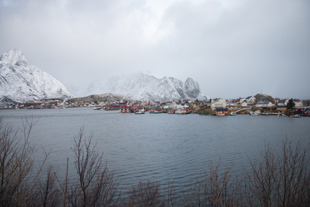 Landscape of dishing house village among the snow with mountain view in Lofoten island Reine Norway