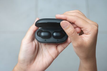 Close up of woman is open the black true wireless earbuds case
