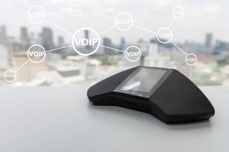 Modern telephone IP conference device with voip icon for teleconference technology connection concept  Standard-Bild
