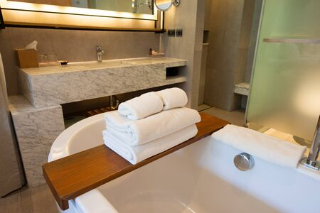 Towels are placed on the bathtub in the luxury hotel