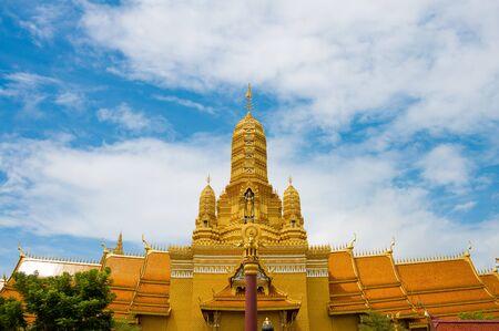 Golden Buddhist church with beautiful sky
