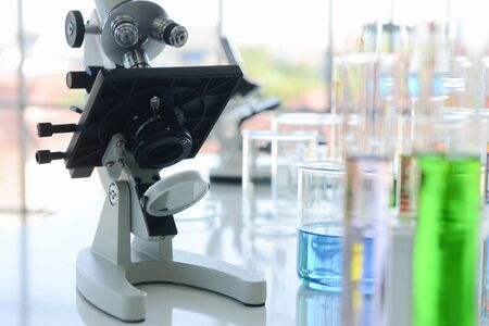 Close up of electron microscope and glass laboratory chemical with chemical compounds inside in chemical lap