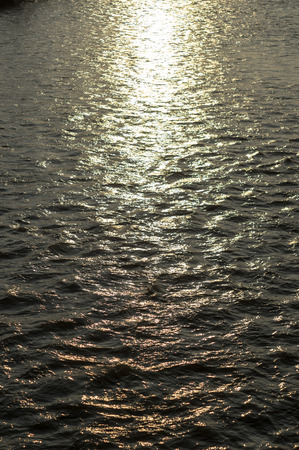 bosna: Photo of river waves at sunset. Made on the bridge over the river Bosna.