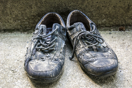 old shoes: Old shoes destroyed during agricultural work. Stock Photo