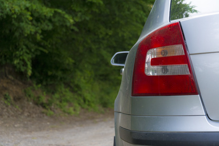 stop light: Photographed stop light on a car parked next to a dirt road. Stock Photo