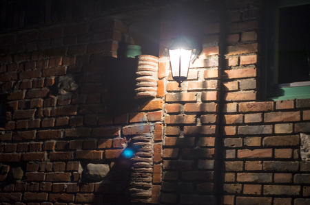 gothic build: Lamp on a brick wall.