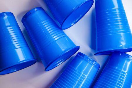 selective focus, blue plastic cups, environmental pollution theme