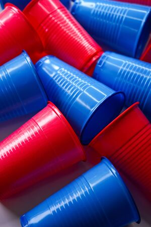 selective focus, blue and red plastic cups, environmental pollution theme Stok Fotoğraf