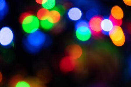 background image, colored round lights in the dark, for Christmas cards and greetings. Degradation