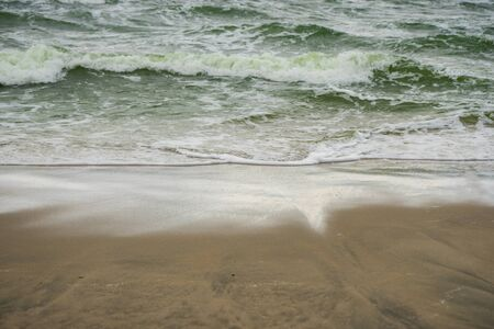 selective focus, formidable Baltic sea in cloudy weather with sandy beach