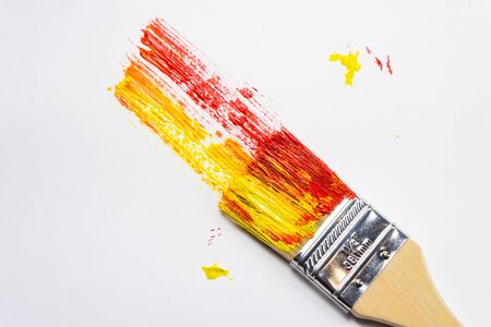 large paint brush with oil color paint, painted bright background with brush marks 免版税图像