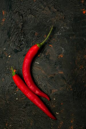 peppers, Cayenne red burning in front of Chile, close-up