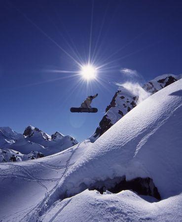 snowboard jump in scenic backcounty photo