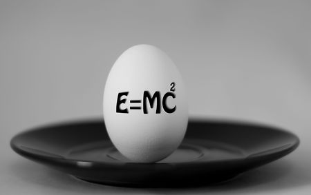 relativity: Egg on a plate, describeing theory of relativity,  with smooth grey background
