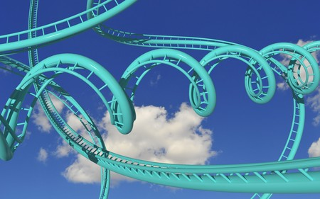madness: crazy rollercoaster trails against blue sky Stock Photo