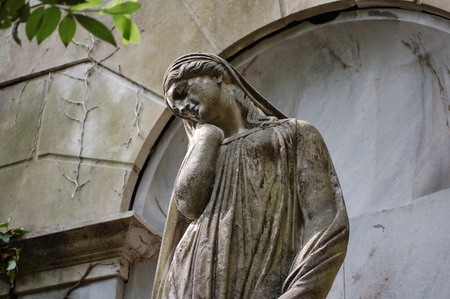 cemetery statue of a suffering woman Stock Photo