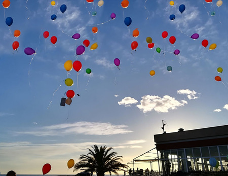 colored balloons flying up in the air. Stock Photo