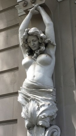 A statue of a woman in front of a shop