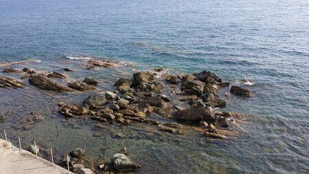 rocks and sea in the summer period Banco de Imagens
