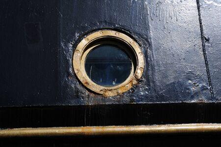 porthole of a vintage sailing ship 스톡 콘텐츠