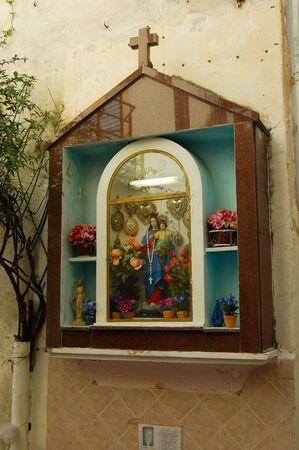 votive shrine dedicated to the Madonna along the road Banco de Imagens
