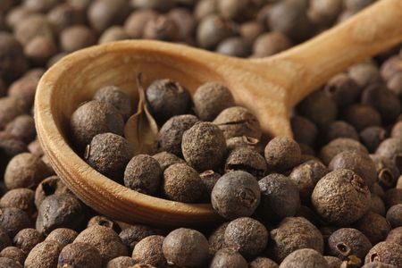 aromatic pepper in wooden spoon Stock Photo
