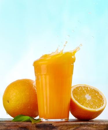 fruit drinks: orange juice splash Stock Photo